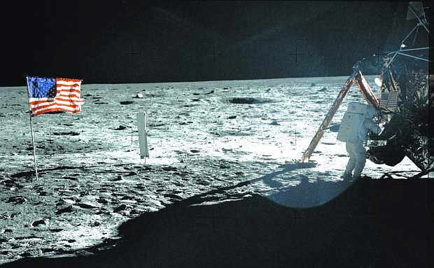 """In this July 20, 1969 photo provided by NASA shows Apollo 11 astronaut Neil Armstrong on the lunar surface. Apollo 11 astronauts trained on Earth to take individual photographs in succession in order to create a series of frames that could be assembled into panoramic images. This frame from Aldrin's panorama of the Apollo 11 landing site is the only good picture of mission commander Neil Armstrong on the lunar surface. The family of Neil Armstrong, the first man to walk on the moon, says he has died at age 82. A statement from the family says he died following complications resulting from cardiovascular procedures. It doesn't say where he died. Armstrong commanded the Apollo 11 spacecraft that landed on the moon July 20, 1969. He radioed back to Earth the historic news of """"one giant leap for mankind."""" Armstrong and fellow astronaut Edwin """"Buzz"""" Aldrin spent nearly three hours walking on the moon, collecting samples, conducting experiments and taking photographs. In all, 12 Americans walked on the moon from 1969 to 1972.  (AP Photo/NASA, Buzz Aldrin)"""