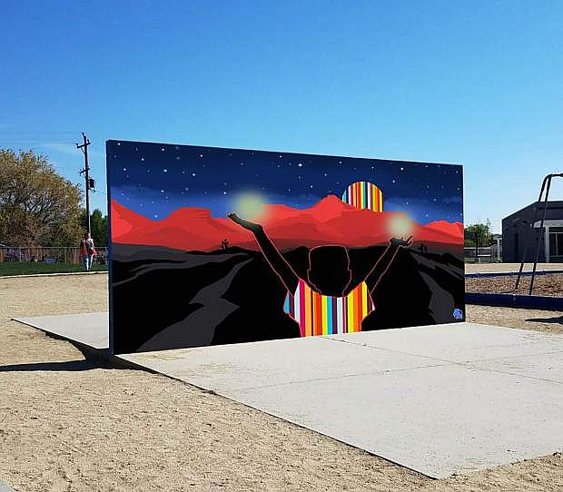 Bill Louis, one of two artists selected to create a mural for the Empire Elementary School playground wall, digitally placed his work on the school's wall.