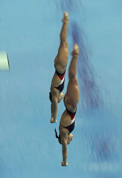 Alison Gibson and Krysta Palmer of the United States compete during the women's 3m synchro springboard final competitions at the World Swimming Championships in Gwangju, South Korea, Monday, July 15, 2019. (AP Photo/Lee Jin-man)
