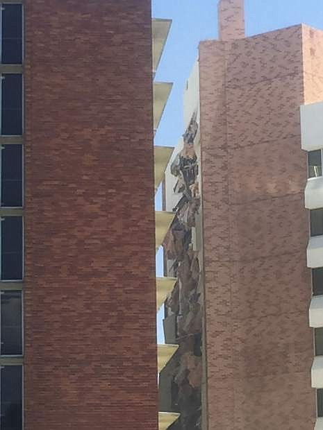 """The aftermath of an explosion inside a residence hall at the University of Nevada, Reno in Reno, Nev., is visible on Friday, July 5, 2019. Police referred to the incident as a """"utilities accident."""" There were no immediate reports of injuries. (Raymond Floyd via The AP)"""