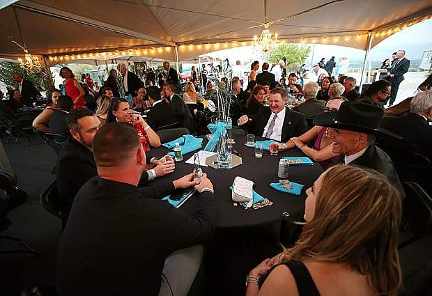 Guests enjoy the Western Nevada College Foundation's Reach for the Stars black-tie gala at the Jack C. Davis Observatory on Aug. 11, 2018.
