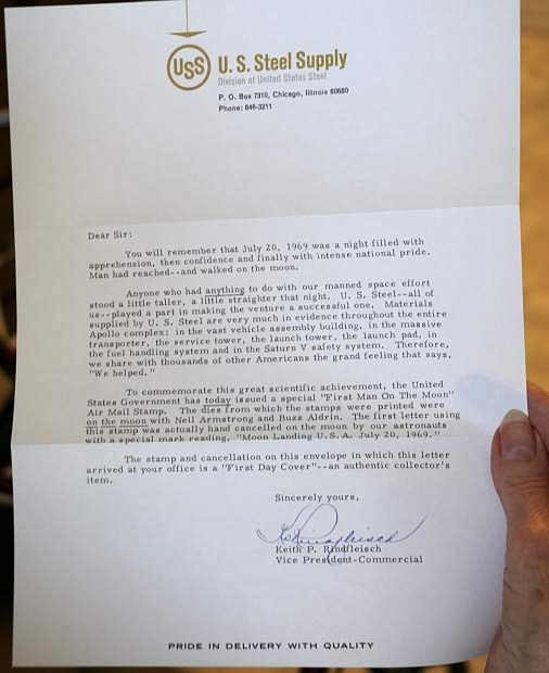 """This letter from U.S. Steel Supply, now in Carson City resident Clo Dierlam's possession, honors the company's contributions to providing materials to build the Apollo complex and Saturn V system.  The letter was signed by U.S. Steel Supply company vice president,  Keith Rindfleisch. The accompanying envelope bears an """"Eagle Has Landed"""" seal and a special """"First Man on the Moon"""" Air Mail stamp was printed with astronauts Neil Armstrong and Buzz Aldrin."""
