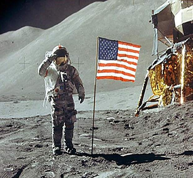 The American flag is planted on the surface of the moon by astronauts during the Apollo 11 space mission.