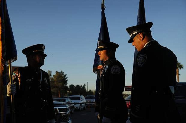 Members of a law enforcement color guard prepare to participate in a ceremony Tuesday, Oct. 1, 2019, on the anniversary of the mass shooting two years earlier in, Las Vegas. (AP Photo/John Locher)