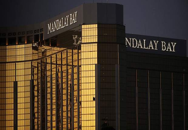 FILE - In this Oct. 3, 2017, file photo, windows are broken at the Mandalay Bay resort and casino in Las Vegas, the room from where Stephen Craig Paddock fired on a nearby music festival, killing 58 and injuring hundreds on Oct. 1, 2017.