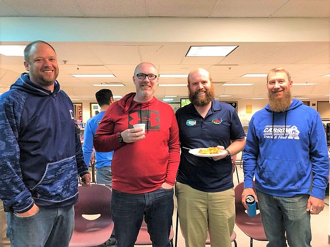CHS Principal Gavin Ward, along with teachers Kyle Anderson, Charles Mann, and Brad Wick enjoying the Coffee Lounge Kick-off provided by the CHS Social Emotional Learning Committee.