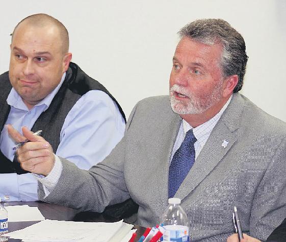 Joel Dunn (right) shown in 2016.