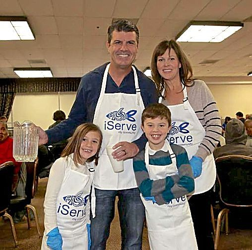Dean DiLullo, Carson Nugget Casino/Hotel owner and general manager, with his family serves dinner at a recent Community Thanksgiving Feast.