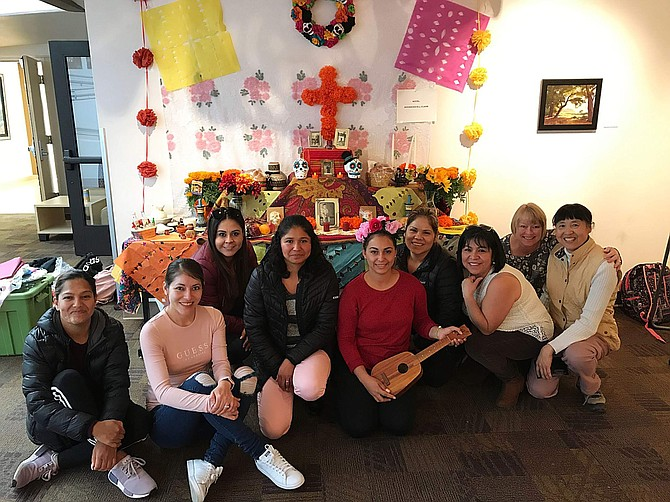 2019 Dia de los Muertos altar contest winners: The winners of the altar contest at the Dia de los Murertos event on Oct. 31, from left, are Erika Romo-Reyes, Azucena Acosta, Nancy Galaviz, Rosa Pureco, Alba Madera, Rafaela Herrera, Maricela Lopez and Hou Ling, with English Language Learning instructor Jody Coxon (second from right).