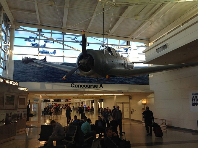 At Chicago's Midway Airport, a SBD-5 Dauntless is suspended from the ceiling. It was squadrons of these dive bombers that attacked and sunk all four of the Japanese carriers at Midway June 4 to 7, 1942.