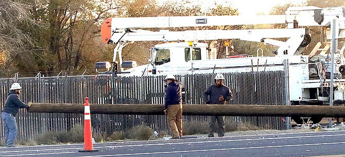 NV Energy crews work to replace electrical poles that had been damaged after a three-vehicle crash last week at U.S. Highway 50 and Sheckler Cutoff.