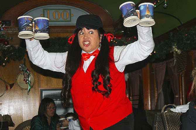 "Anita Kelley sings and dances to the ""Hot Chocolate"" song on the V&T Railroad Polar Express train in 2017. Nevada Appeal file photo"