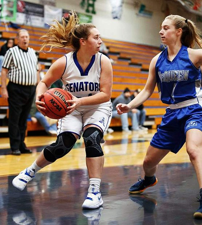Bella Kordonowy stops underneather hoop during a contest against McQueen last season. Kordonowy averaged 9.4 points per game and 6.9 rebounds per game last season and will be expected to lead the Senators this season as a senior.