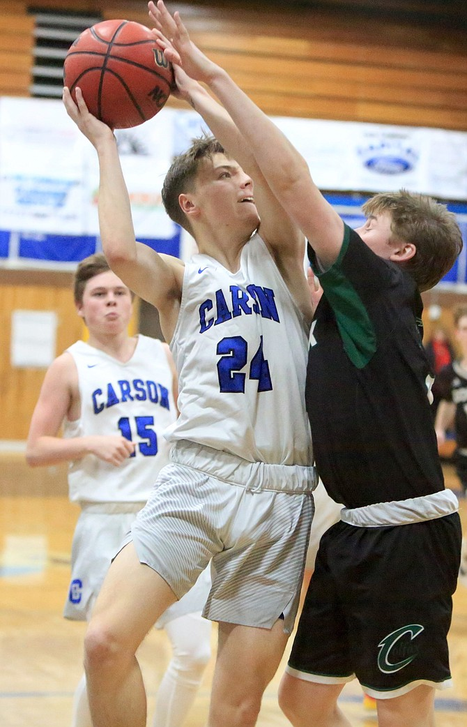 Carson High's Joey Summers fights for a layup during his 37-point outburst against Colfax Friday,