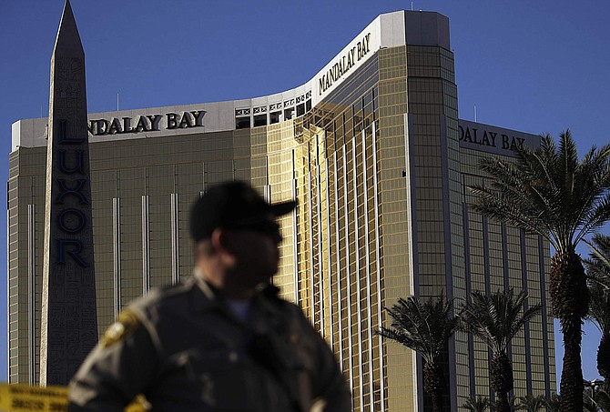 A Las Vegas police officer stands by a blocked off area near the Mandalay Bay casino on Oct. 3, 2017 following a mass shooting in Las Vegas.