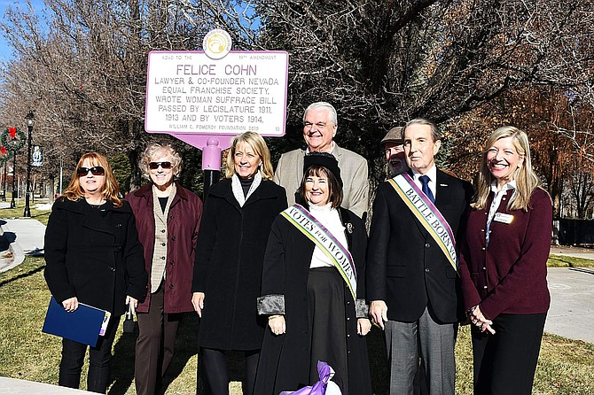 Gov. Steve Sisolak, Mayor Bob Crowell, Nevada Secretary of State Barbara Cegavske and others stand in front of the new historic marker honoring Carson City's Felice Cohn.