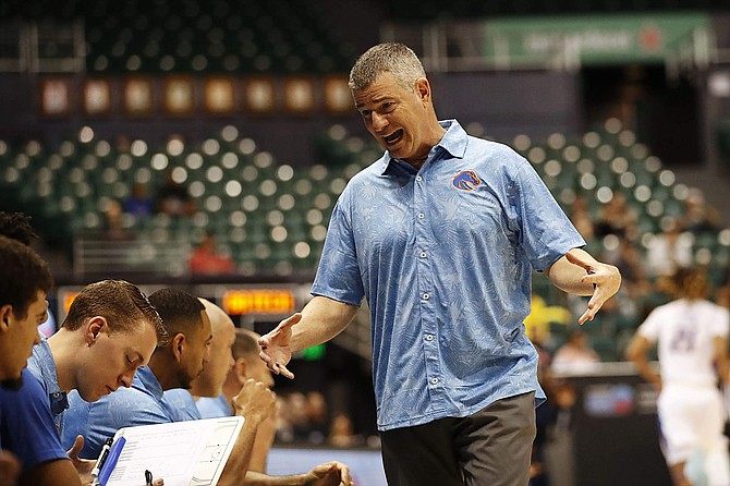 Boise State head coach Leon Rice talks to his bench while playing Georgia Tech on Dec. 22 in Honolulu.