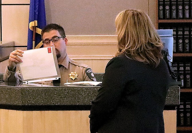Deputy District Attorney Chelsea Sanford ha Churchill County Sheriff Sgt. Chris Thorne look at photos of a murder victim on the same day a fatal shooting occurred in Fallon on July 22, 2018.