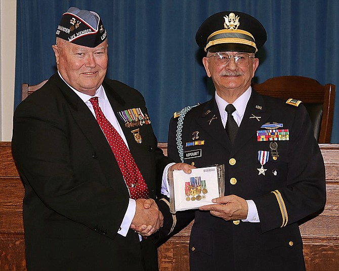 George Malone, left, national commander of the Legion of Valor, presents Andrew LePeilbet with a miniature uniform ribbon bar.