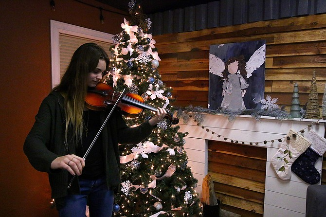 Claire Benson, 19, a University of Nevada, Reno student, plays the violin passed down to her by Carson City resident Sue Cook. The violin, which she inherited from her father, Arthur Tesmer, in 1981, is at least 110 years old. The instrument was restored after the new owners who purchased Cook's house suggested Benson as a possible recipient and as someone who has a heart for music.