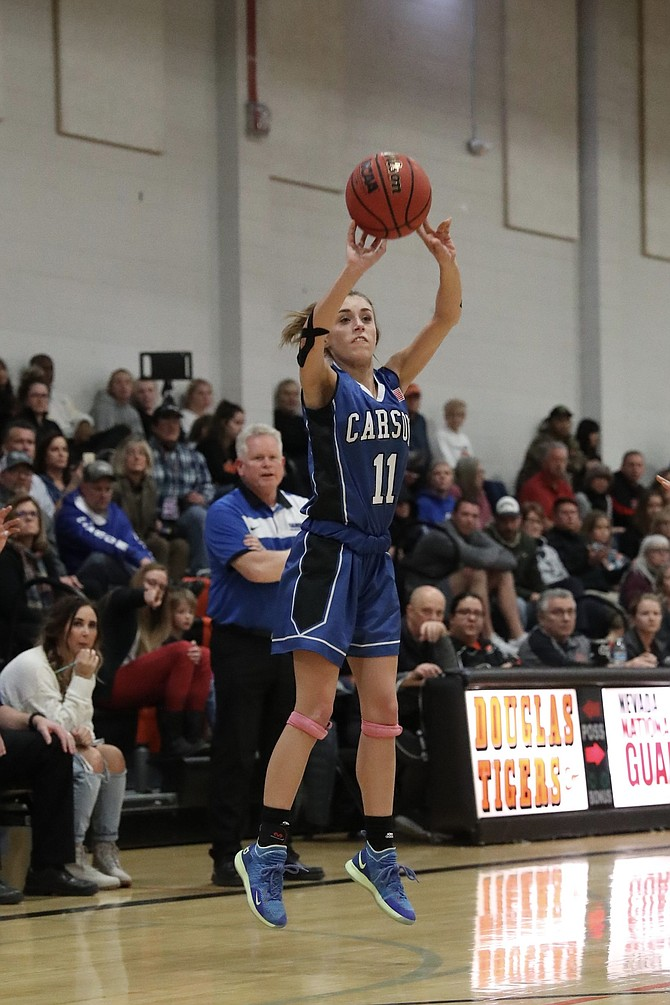 Abby Golik shoots a 3-pointer during the third quarter in which she hit two triples. Golik ended the night with 11 points as Carson bested Douglas 47-33.
