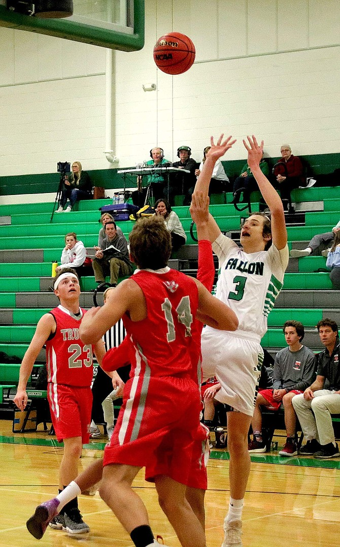 Avery Strasdin (3) scores his third basket for Fallon in the first quarter of the Greenwave's game against Truckee.
