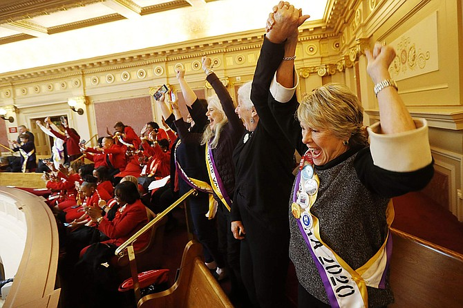 Equal Rights Amendment supporter Donna Granski, right, from Midlothian Va., cheers the passage of the House ERA Resolution in the Senate chambers at the Capitol in Richmond, Va. Monday, Jan. 27, 2020. The resolution passed 27-12. (AP Photo/Steve Helber)