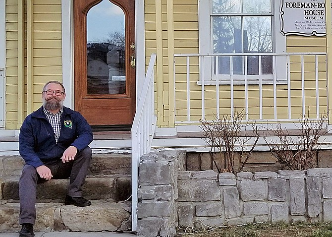 Carson City Historical Society newly elected president Jeff Loflin sits on the steps of the restored Foreman-Roberts House.