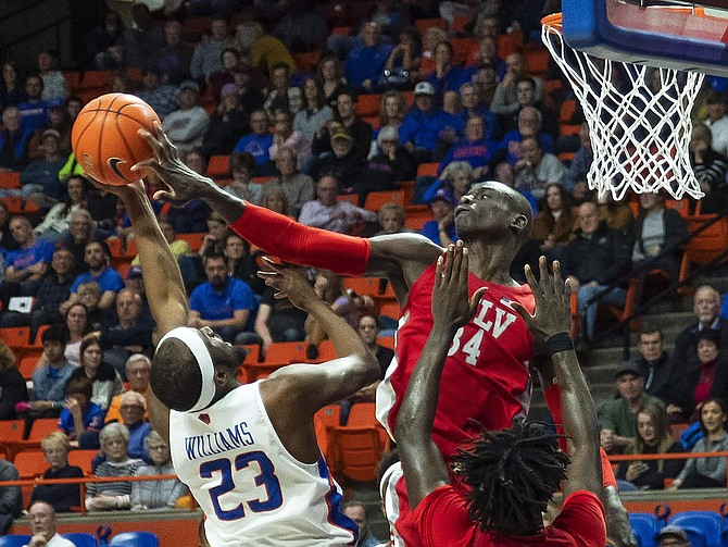UNLV forward Cheikh Mbacke Diong blocks a shot by Boise State guard RJ Williams but is called for a foul during an NCAA college basketball game Wednesday, Jan. 8, 2020, in Boise, Idaho. (Darin Oswald/Idaho Statesman via AP)