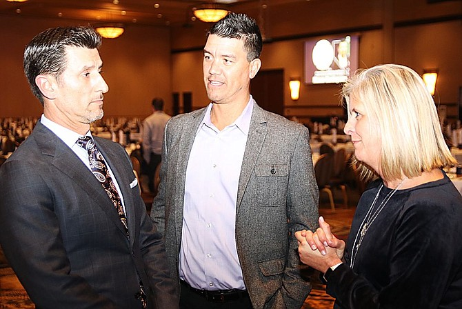 Nomar Garciaparra, left, meets with Nevada head baseball coach T.J Bruce and Holly Aycock, assistant athletic director for marketing and promotions, before the Bobby Dolan Dinner on Thursday.