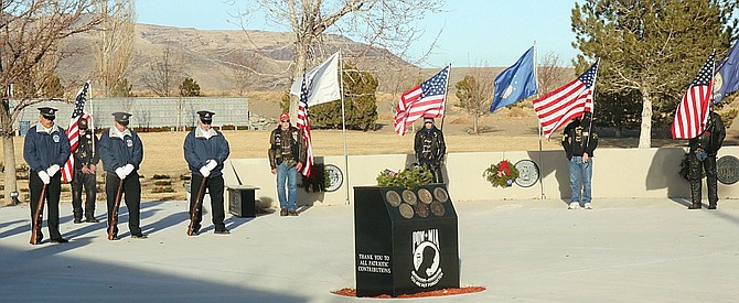Members of the Nevada Veterans Coalition and Patriot Guard Riders stand at attention.