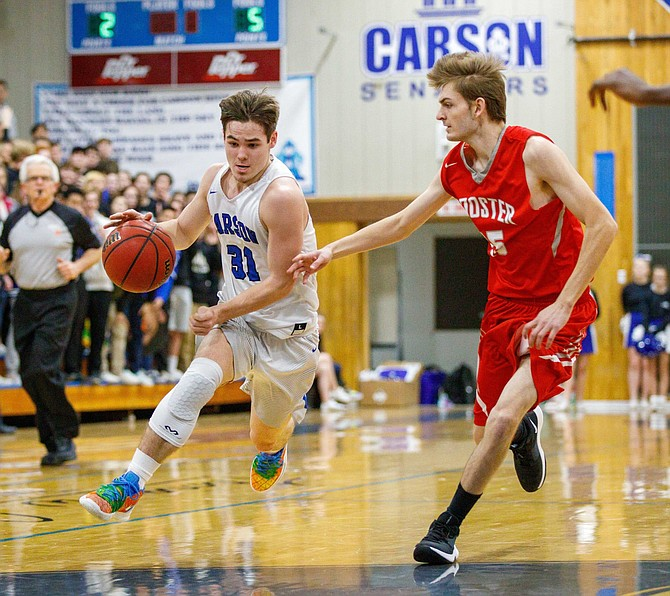 Carson High forward Nathan Smothers drives toward the key during the NIAA Northern Division 4A game between the Wooster Colts and Carson Senators at Carson High School, Carson City, NV