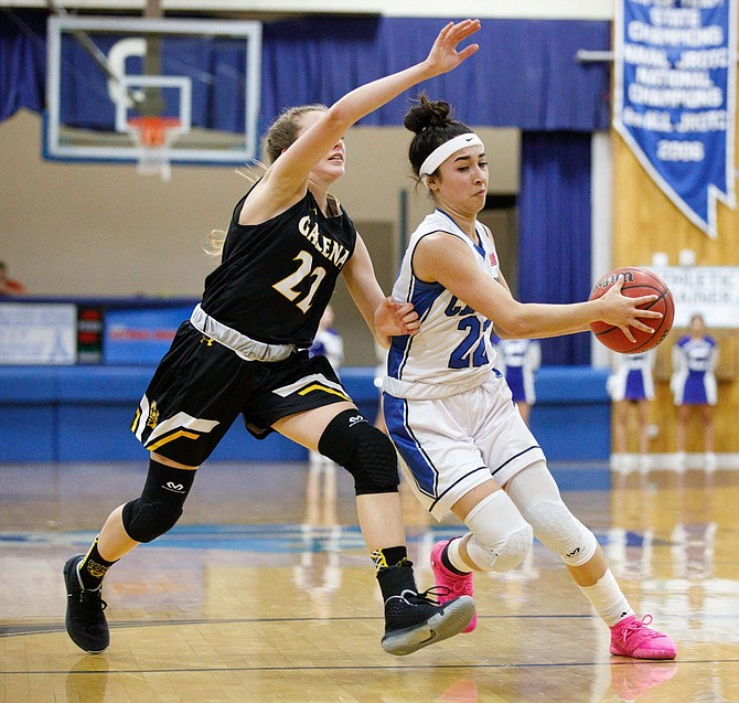 Carson High Guard Lily Bouza drives to the basket during the NIAA Northern Division 4A game between the Galena Grizzlies and Carson Senators at Carson High School.