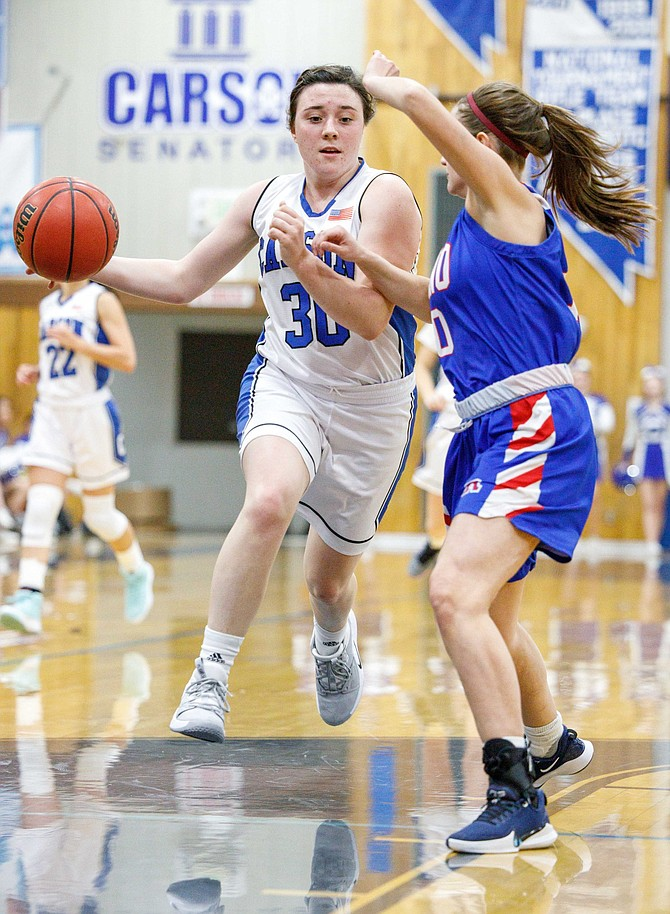 Carson High's Camryn Quilling drives to the hoop during the NIAA Northern Division 4A game between the Reno Huskies and Carson Senators at Carson High.