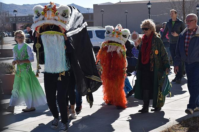 Lion Dancers lead the crowd out of the Dema Guinn Concourse at the Nevada State Museum during the 2018 Chinese New Year Celebration.