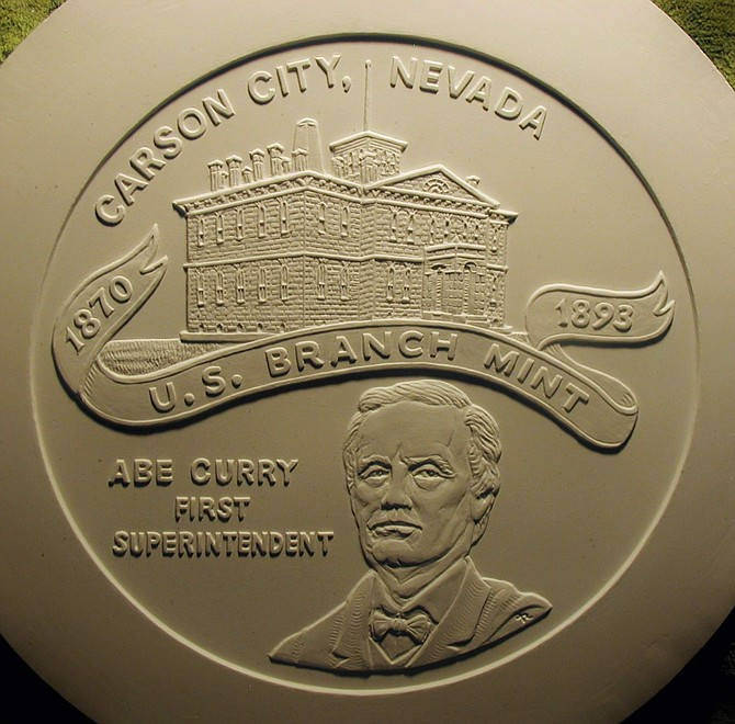 The engraving of the medallion celebrating the 150th anniversary of the opening of the Carson City Mint shows the mint building and its first superintendent, Carson City founder Abe Curry. The engraving was done by retired U.S. Mint engraver Tom Rogers.
