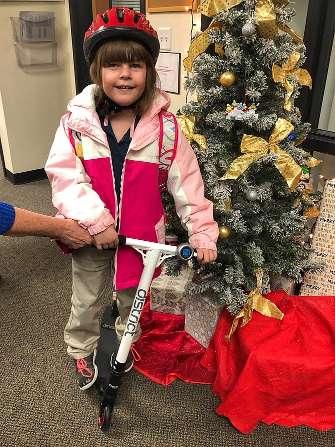 Adria Bass, a kindergartner from Bordewich Bray Elementary School, won a new custom scooter from WheelHouse, a local scooter company.