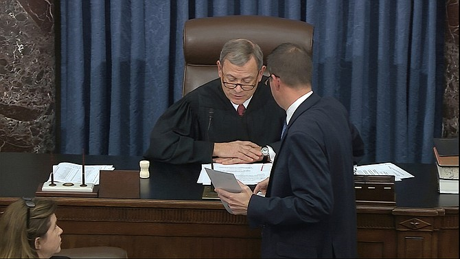 In this image from video, presiding officer Chief Justice of the United States John Roberts reads the results of the vote on the first article of impeachment, abuse of power, during the impeachment trial against President Donald Trump in the Senate at the U.S. Capitol in Washington, Wednesday, Feb. 5, 2020. The Senate vote for not guilty was 52-48. (Senate Television via AP)