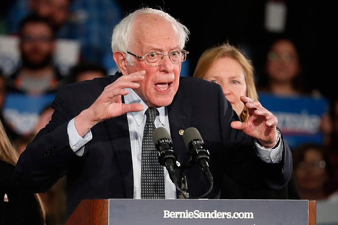 Democratic presidential candidate Sen. Bernie Sanders, I-Vt., with his wife Jane O'Meara Sanders, speaks to supporters at a caucus night campaign rally in Des Moines, Iowa, Monday, Feb. 3, 2020. (AP Photo/Pablo Martinez Monsivais)