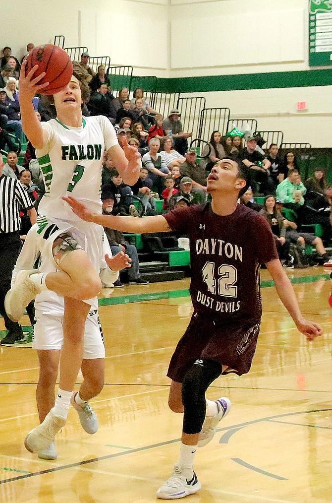 Avery Strasdin (3) of Fallon leaves the floor for a layup against Dayton.