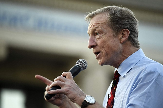 Democratic presidential hopeful Tom Steyer speaks at a campaign block party Sunday in Winnsboro, S.C.