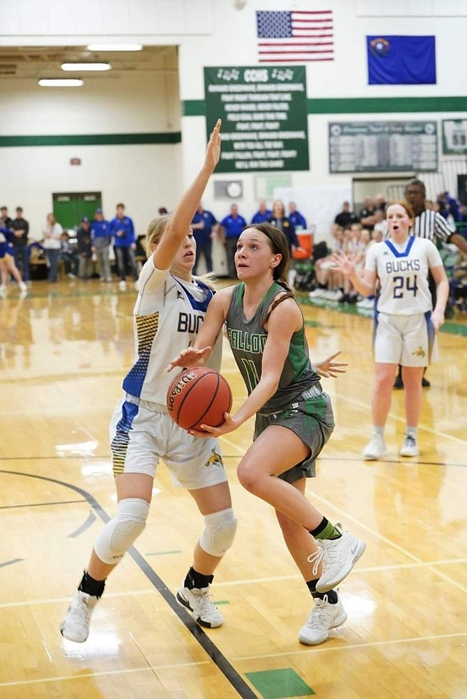 Fallon's  Makenzee Moretto (11) drives for a layup against Lowry's McKenzi Peterson.