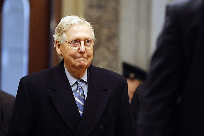 Senate Majority Leader Mitch McConnell arrives at the U.S. Capitol in Washington on Friday.