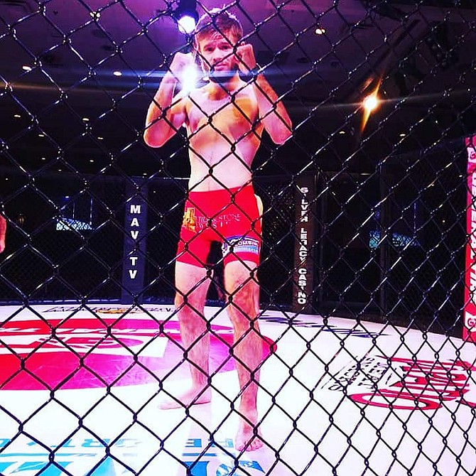Brady O'Keefe poses for a photo during his first appearance at King of the Cage Reno.