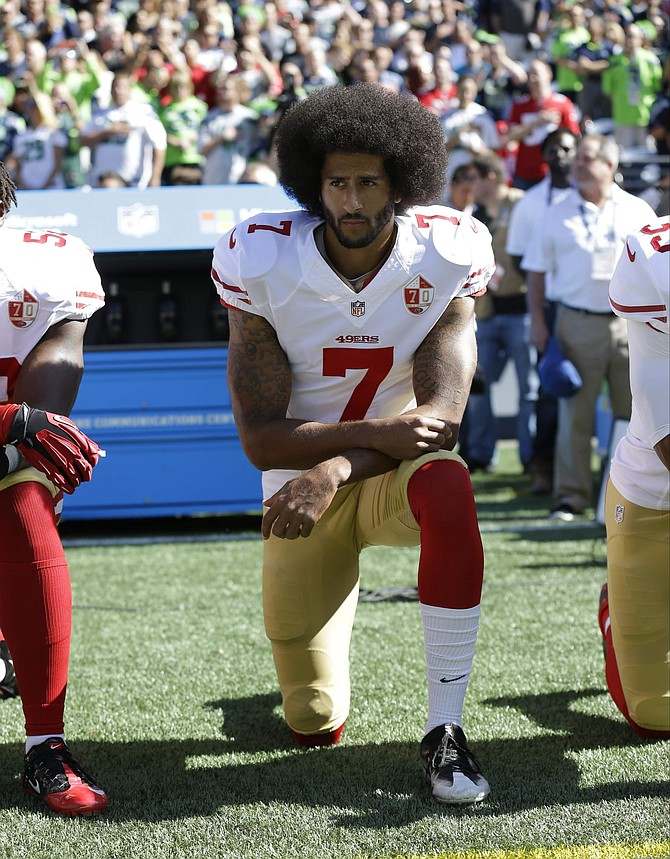 FILE - In this Sept. 25, 2016, file photo, San Francisco 49ers' Colin Kaepernick kneels during the national anthem before an NFL football game against the Seattle Seahawks in Seattle. The same guys who banished Kaepernick from the league for kneeling during the anthem to raise awareness about those very same issues have ruthlessly commandeered his cause. (AP Photo/Ted S. Warren, File)