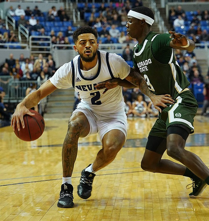 Jalen Harris, shown against Colorado State's Kendle Moore on Jan. 1, has a chance to set Nevada's single-season scoring record.