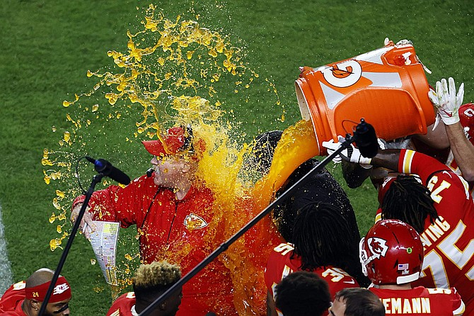 Kansas City Chiefs head coach Andy Reid has Gatorade pored on him as the Chiefs defeated the San Francisco 49ers in the NFL Super Bowl 54 football game Sunday, Feb. 2, 2020, in Miami Gardens, Fla. (AP Photo/Adam Hunger)