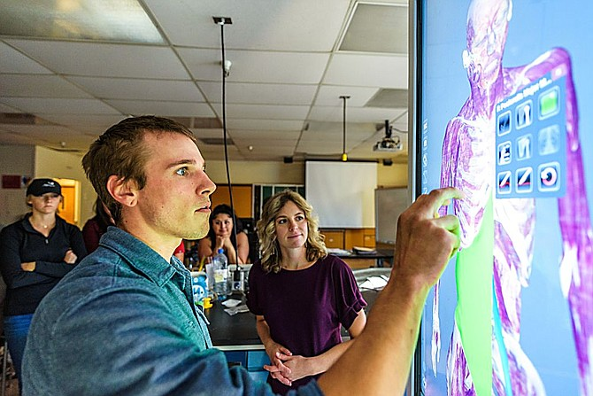 Lain Crawford works in a Human Anatomy and Physiology class on a new anatomage table, a type of virtual reality dissection tool, at Western Nevada College, in Carson City, Nev., on Thursday, Oct. 17, 2019.