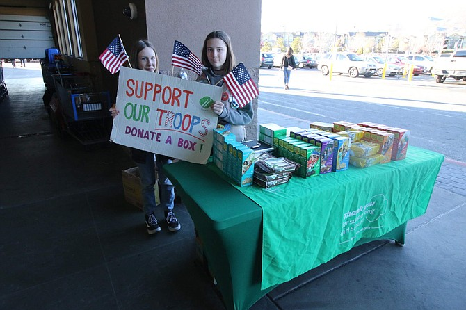 Pearl King, 11, and Ellie Loos, 12, both Carson Middle School students and members of Carson City's Girl Scout Troop 164, participate in their organization's annual fundraising efforts Wednesday by selling cookies at the Market Street Walmart. Both Girl Scouts have taken part in their troop's activities by going on trips or assisting at the local animal shelter.