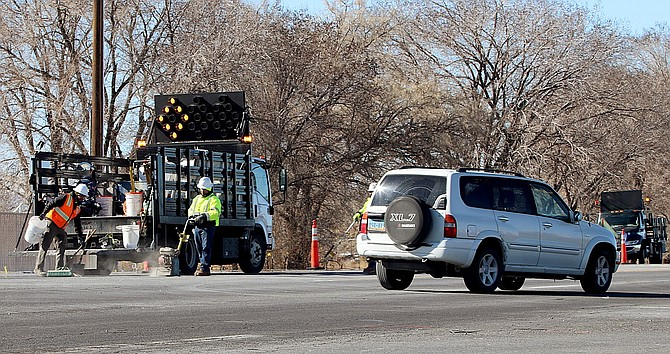 Workers prepare the northwest corner of U.S. Highway 50 and Sheckler Cutoff on Monday for temporary traffic lights.